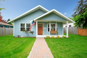 26838604 - small clapboard siding house  view of porch with bench and walkway