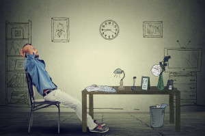 47505495 - young businessman relaxing sitting in the office