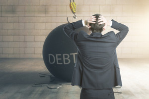 68725750 - debt concept. stressed businessman with wrecking ball