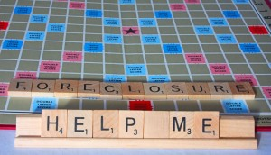 12358307 - a cry for financial help spelled out on a board game.
