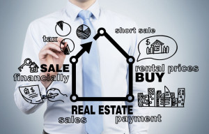 37584810 - businessman drawing real estate concept on blue background