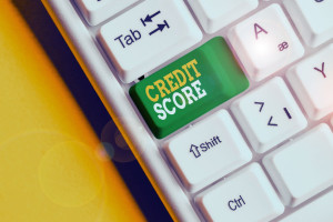 Conceptual hand writing showing Credit Score. Business photo text Represent the creditworthiness of an individual Lenders rating White pc keyboard with note paper above the white background.